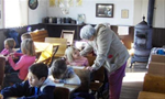 Cardinal 1st graders visit Millrock to learn about one-room schoolhouses