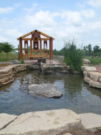 Playscape arbor and water feature