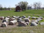 Rock Clock with historic barn