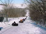 Tubing in the winter - Enjoy a nice winter day out at the park, sliding down the tubing hill with your family and friends.