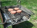 Grilling burgers with a veggie bundle