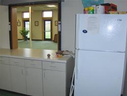 in kitchen, looking north into community room